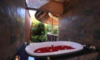 The Kunja Bathtub with Rose Petals | Seminyak, Bali