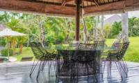 Villa Palm River Outdoor Dining Area | Pererenan, Bali
