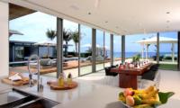 Sava Beach Villas Villa Amarelo Dining Area with Pool View | Natai, Phang Nga