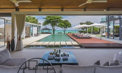 Sava Beach Villas Villa Cielo Indoor Living Area with Pool View | Natai, Phang Nga