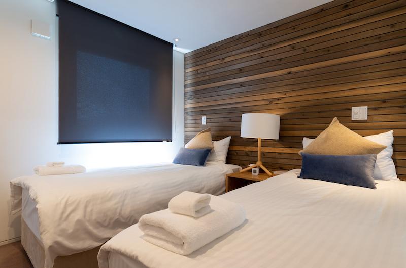 Kawasemi Residence Twin Bedroom with Pillows | Hirafu, Niseko