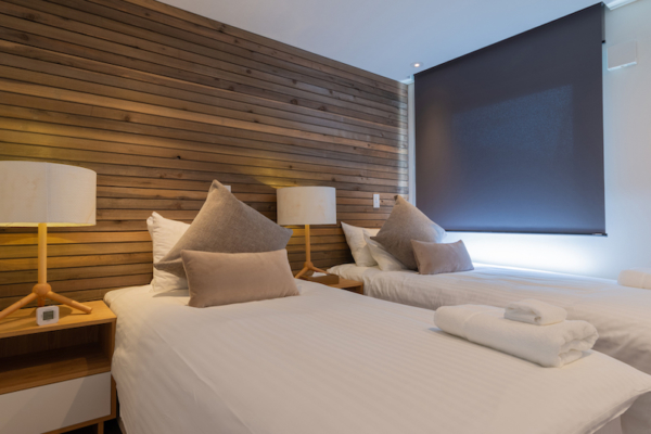 Kawasemi Residence Twin Bedroom with Lamps | Hirafu, Niseko