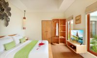 Ini Vie Villa Bedroom Area with TV | Legian, Bali