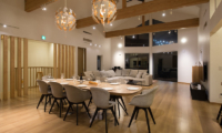 The Orchards Niseko Sawara Living and Dining Area Night View | St Moritz, Niseko