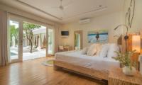 Villa Savasana Bedroom with Wooden Bed | Canggu, Bali