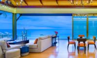 Malaiwana Villa Haleana Indoor Living Area with Pool View | Naithon, Phuket