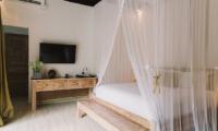 Villa Sungai Bali Villa Gold Bedroom with TV | Tabanan, Bali