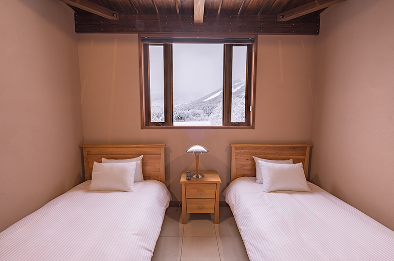 Powderhouse Twin Bedroom Area | Hakuba, Nagano