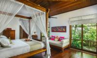 Villa Bukit Naga Bedroom with Couch and Garden View | Gianyar, Bali