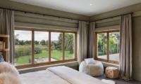 Ataahua Lodge Spacious Bedroom | Whakamarama, Bay of Plenty
