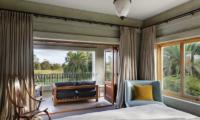 Ataahua Lodge Bedroom with Balcony | Whakamarama, Bay of Plenty