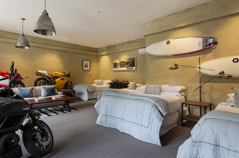 Ataahua Lodge Twin Bedroom with Motorcycle Model | Whakamarama, Bay of Plenty