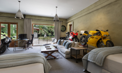 Ataahua Lodge Bedroom with Motorcycle Model | Whakamarama, Bay of Plenty