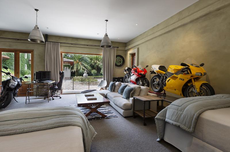 Ataahua Lodge Bedroom with Motorcycle Model | Whakamarama, Bay of Plenty