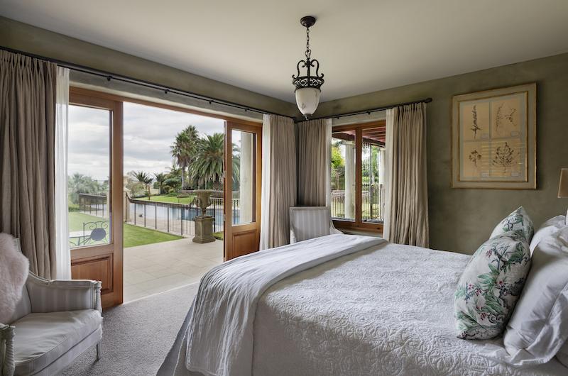 Ataahua Lodge Master Bedroom with Seating | Whakamarama, Bay of Plenty