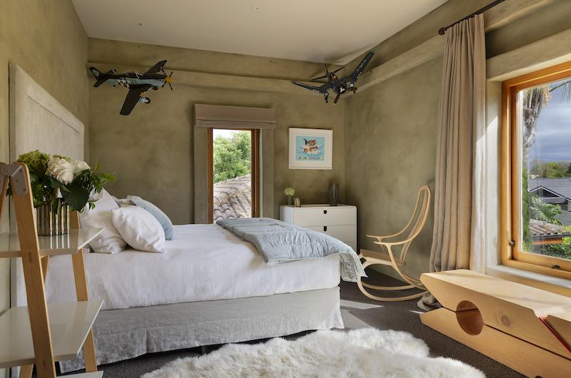 Ataahua Lodge Bedroom with Plane Model | Whakamarama, Bay of Plenty