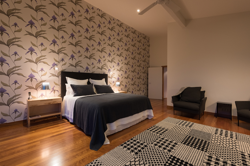 Otaha Beachfront Lodge Bedroom with Wooden Floor | Bay of Islands, Northland