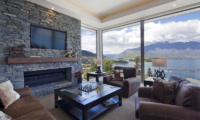 Aspen House Living Area with Fireplace Lake View | Queenstown, Otago
